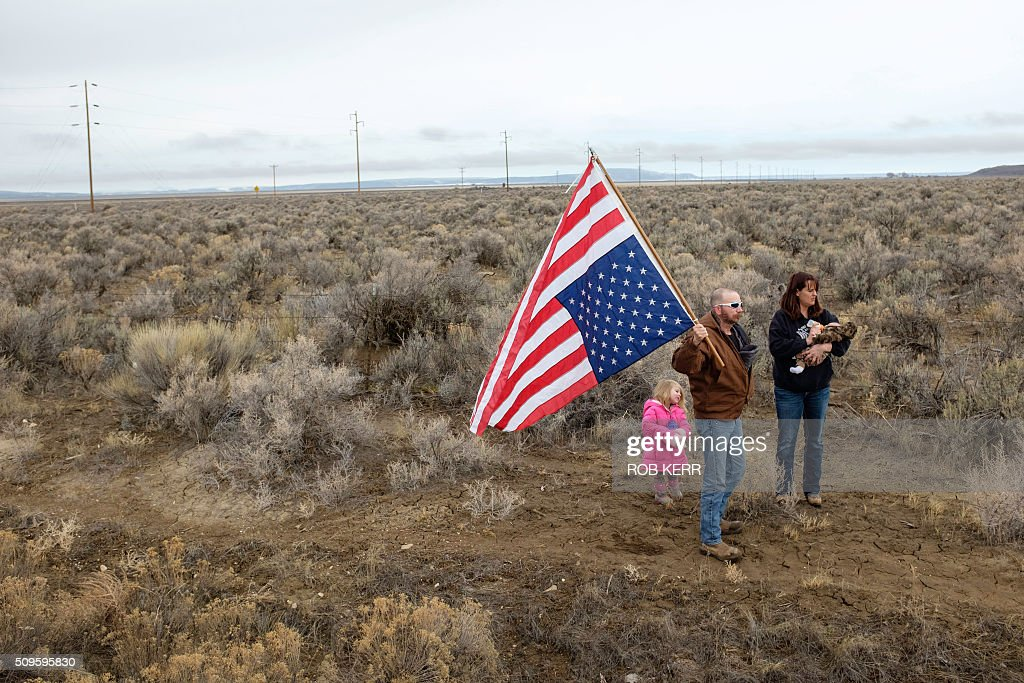A family expresses their support for occupiers at the Malheur Wildlife Refuge Headquarters near Burns, Oregon. The 41-day occupation of the federal wildlife refuge concluded with the arrest of a final four occupants on February 11, 2016. The FBI surrounded the last protesters holed up at a federal wildlife refuge in Oregon amid reports they will surrender on Thursday, suggesting the weeks-long armed siege is approaching a climax. / AFP / Rob Kerr
