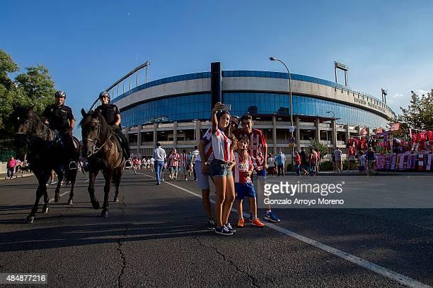 A family fan of Afletico de Madrid takes a selfie ahead Vicente Calderon Stadium before the La Liga match between Club Atletico de Madrid and UD Las...