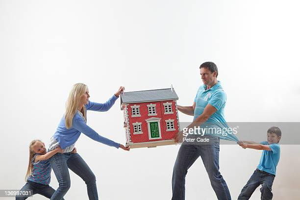 family fighting over dolls house