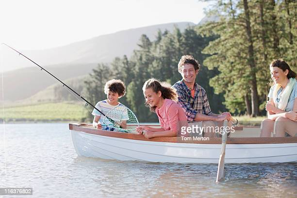 Couple in boat stock photos and pictures getty images for Best boat for fishing and family