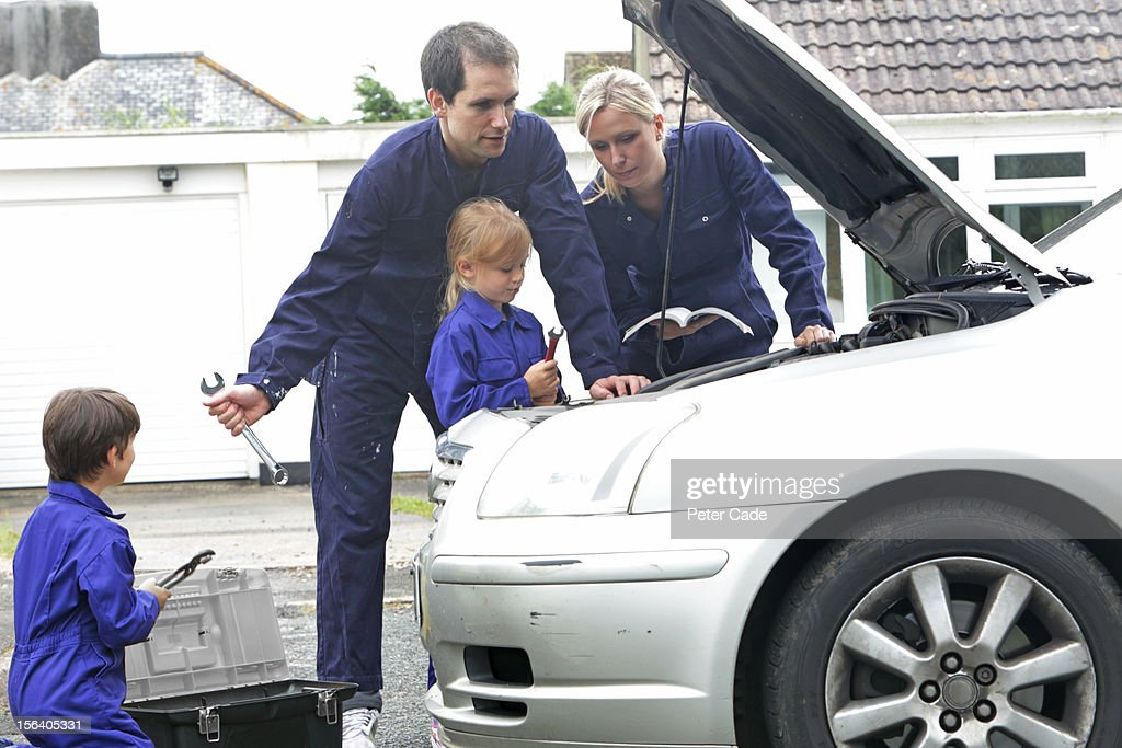Family fixing car : Stock Photo