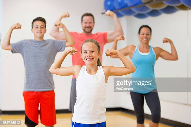 Family Flexing Their Muscles Together