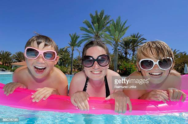 Family floating in pool