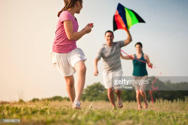 Family flying kite together
