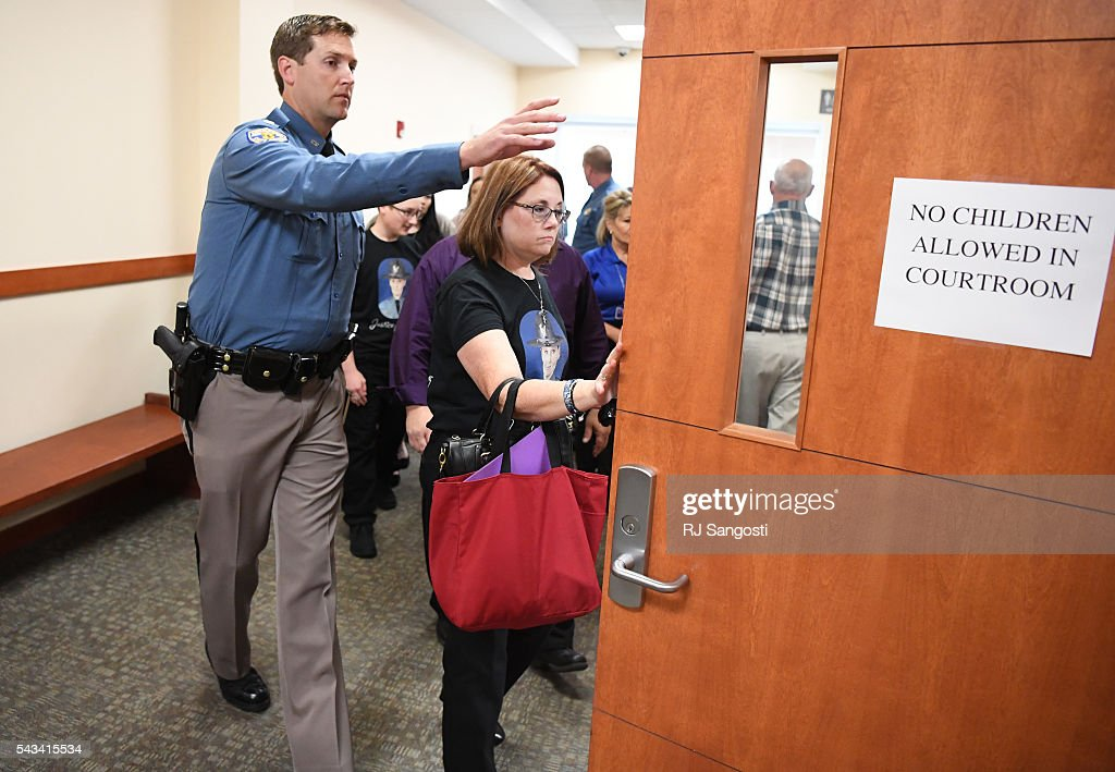 Family, friends, and coworkers of Colorado State Patrol Trooper Jaimie Jursevics arrive at the Douglas County courthouse for the sentencing hearing for Eric Henderson in the death of Jursevics, June 28, 2016.