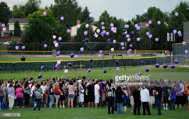 Family friends and former classmates of movie theater shooting victim AJ Boik release balloons during a memorial service at Gateway High School on...