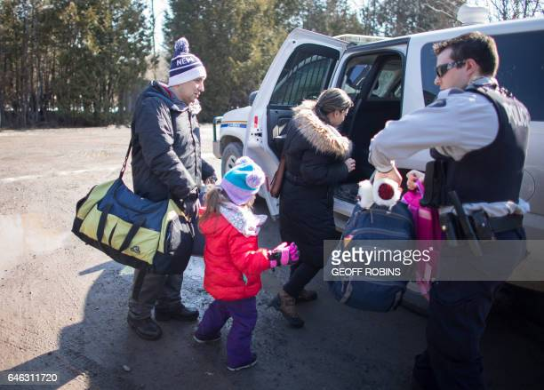 A family from Colombia is arrested by the RCMP after they illegally crossed the USCanada border near Hemmingford Quebec February 28 2017 / AFP /...