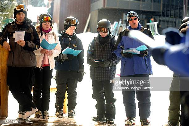 A family from Colorado Springs Colorado attends the Copper Mountain Community Church service on the ski slopes of Copper Mountain Colorado on Sunday...