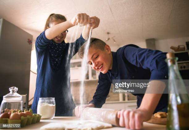 family funny kids bake cookies in kitchen