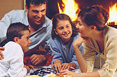 Family game night by fireplace