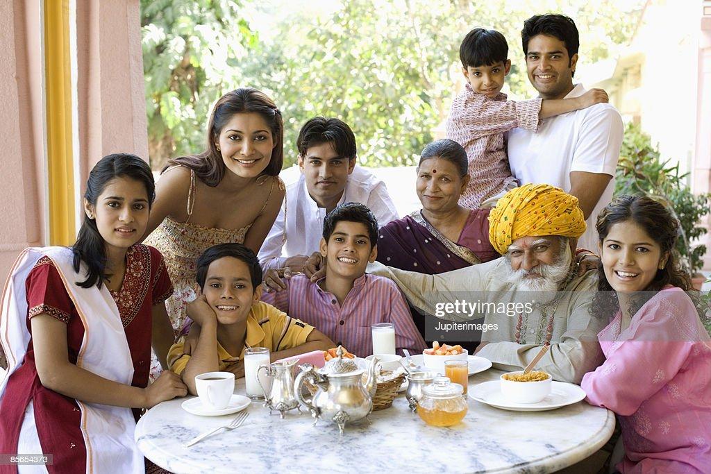 Family gathered around breakfast table : Stock Photo