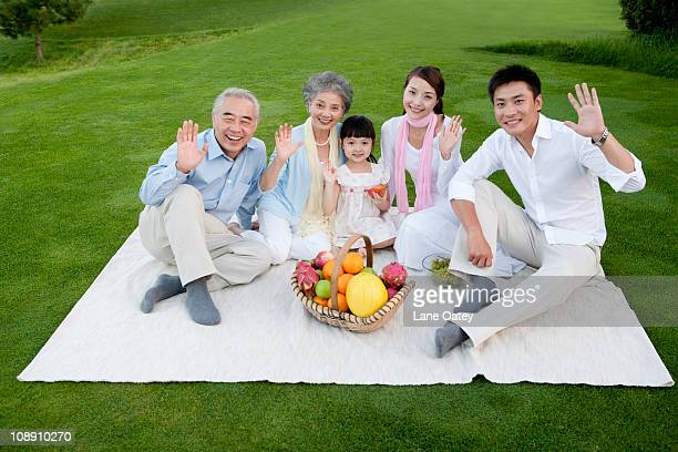 A family gathered around for a picnic