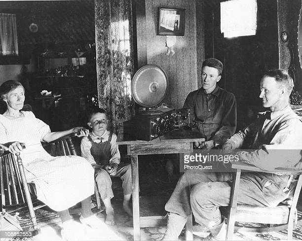 A family gathers around and listens to the radio Hood River Oregon July 1925