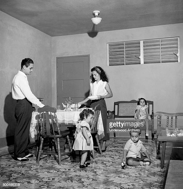 A family gets ready for their first family dinner in a new apartment at the Llorens Torres Housing Development San Juan Puerto Rico September 1953