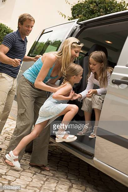 Family getting into car