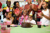 Family giving birthday party to grandmother