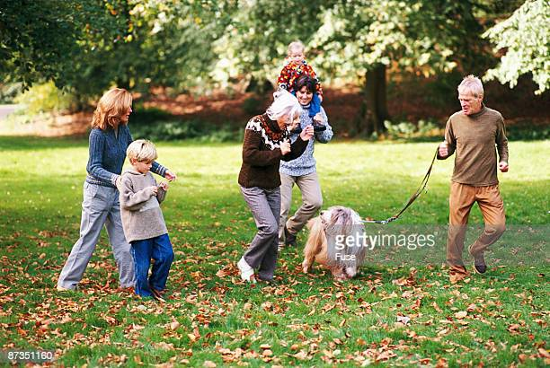 Family going for a walk with dog