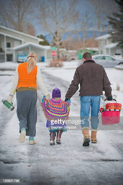 family going out for a Winter picnic