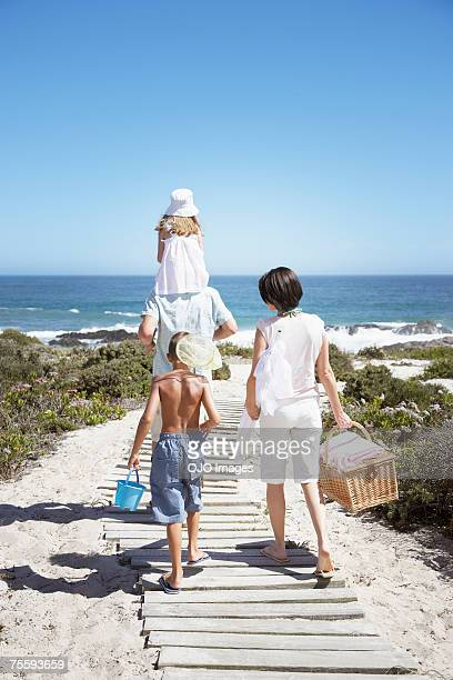 A family going to have a picnic at the beach