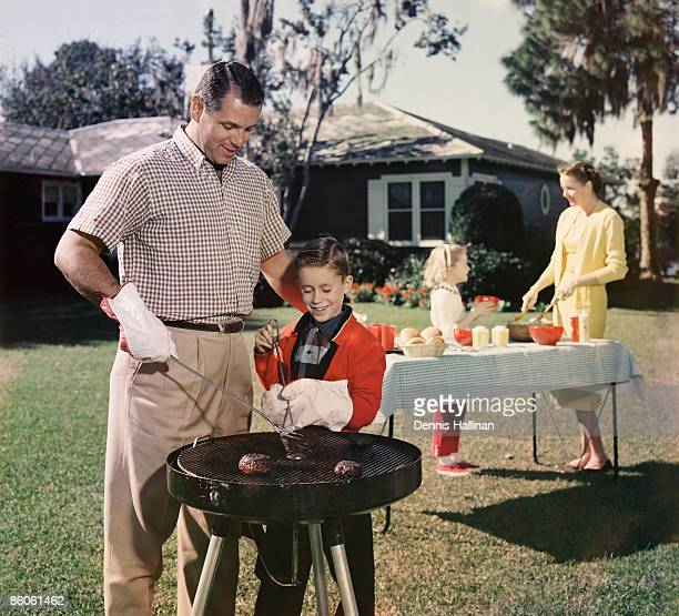 Family grilling in backyard