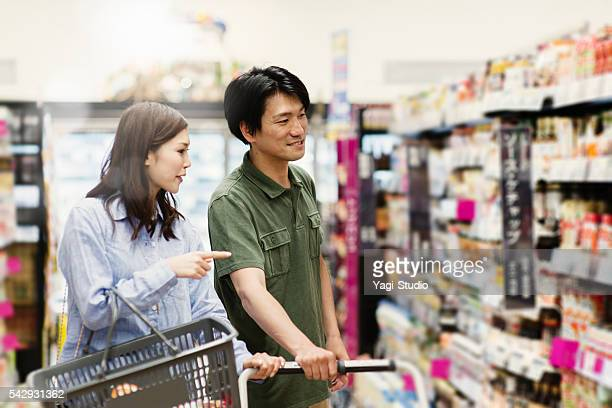 Family grocery shopping at the supermarket