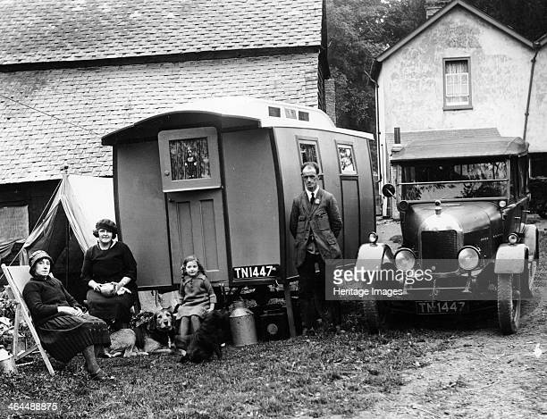Family group with a 1925 Morris Oxford 14/28 and caravan