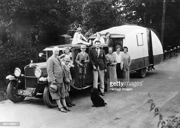 Family group with their 1930 Fiat towing a caravan