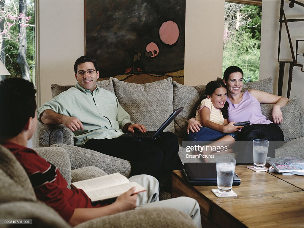 Family Hanging Out In Living Room Stock Photo Getty Images