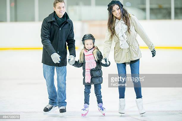 Family Happily Ice Skating Together