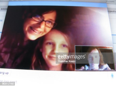 Family has a Web Chat : Stock Photo