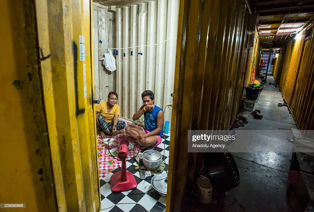 A family have dinner in the house at a construction workers' camp on May 6, 2016 in Bangkok, Thailand. Mainly migrants from neighboring countries, like Cambodia and Laos, live in this camp, which has grocery shops, a common washing area and even a small school, on the outskirts of Bangkok.
