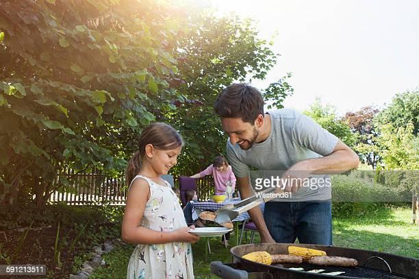 Family having a barbecue in garden