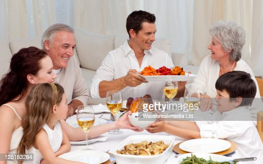 Family having a big dinner at home : Stock Photo