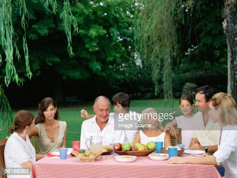 Family having a meal in the garden : Stock Photo