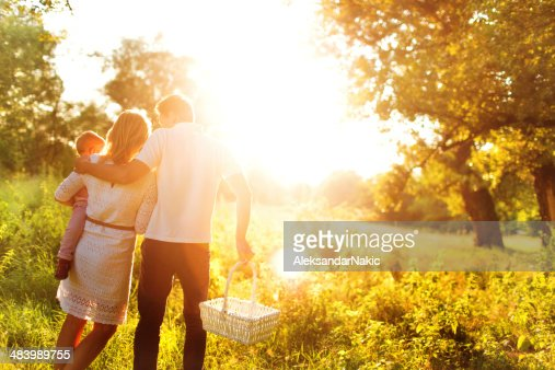 A family having a picnic in a brightly lit field