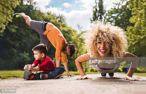 Family having a sports training in the park.