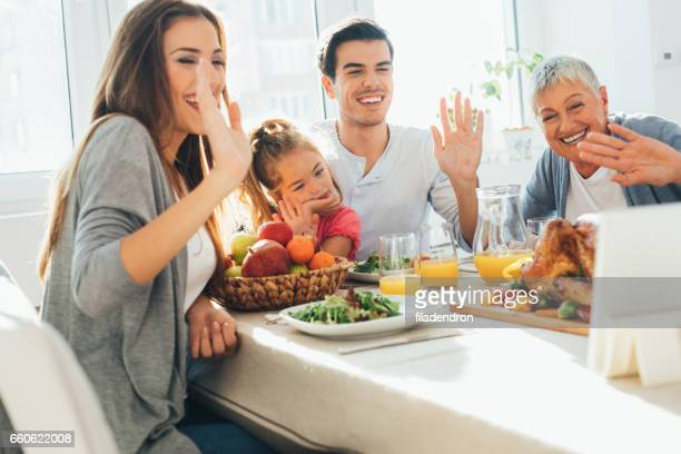 Family having a video call during dinner