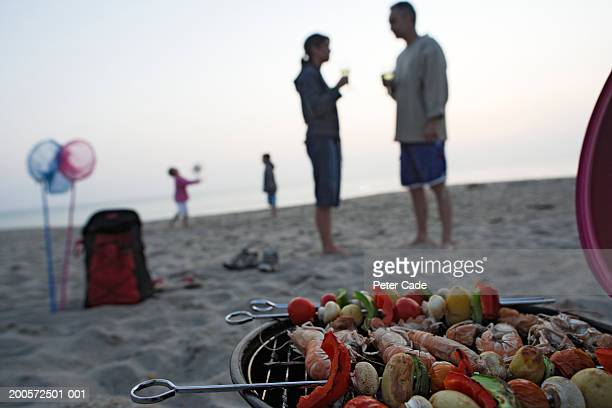 Family having barbeque on beach
