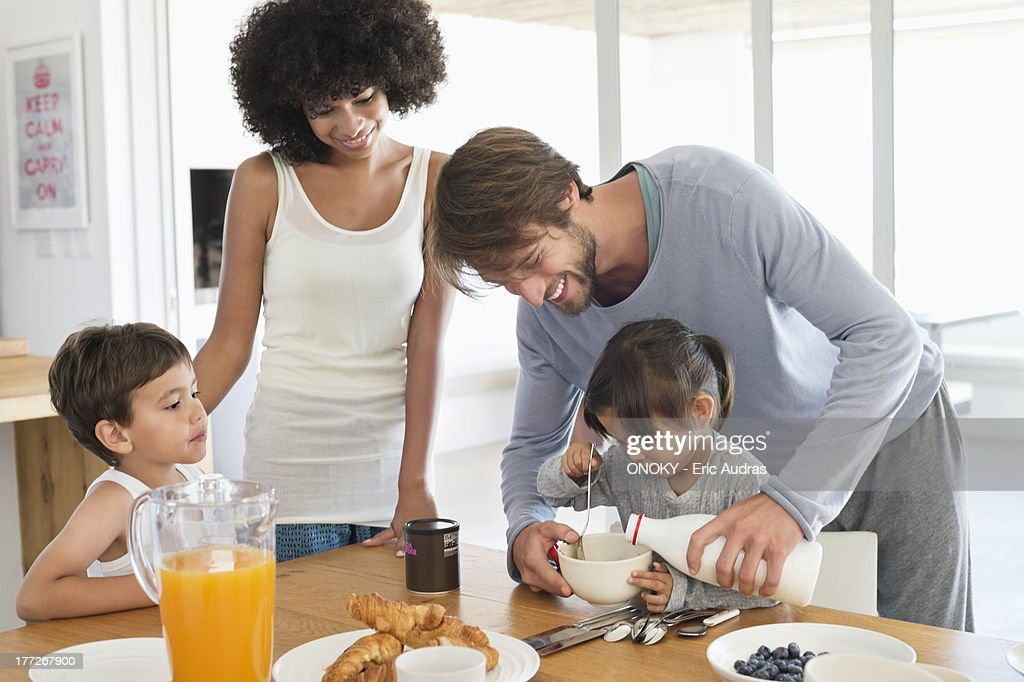 Family having breakfast at a dining table