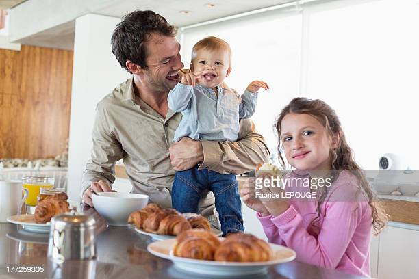 Family having breakfast at a kitchen counter