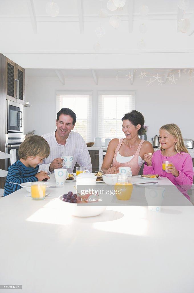 Family having breakfast at the dining table : Stock Photo