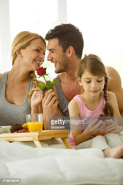 Family having breakfast in bed