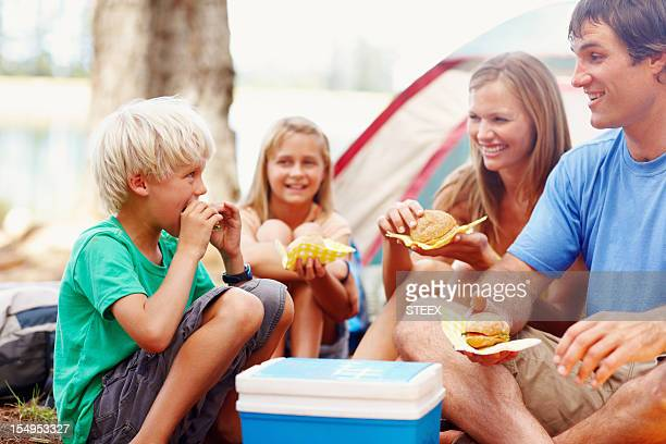 Family having breakfast while camping
