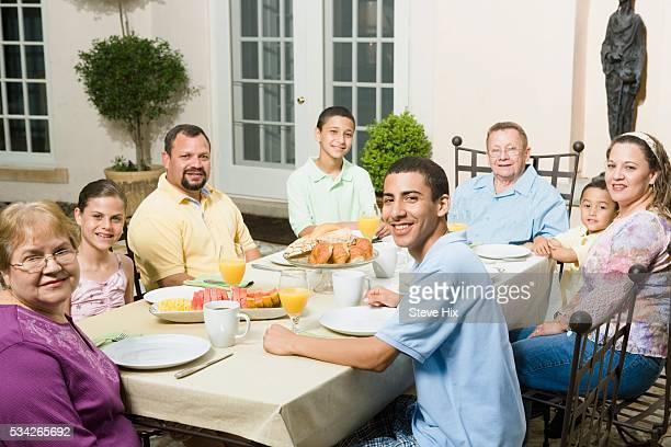 Family Having Brunch Outdoors