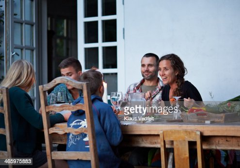 Family having dinner at outside dinner table