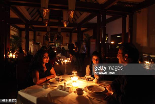 Family having Dinner during the Earth Hour at ITC Hotels Mumbai a global campaign to switch off their light for one hour to highlight the campaign...