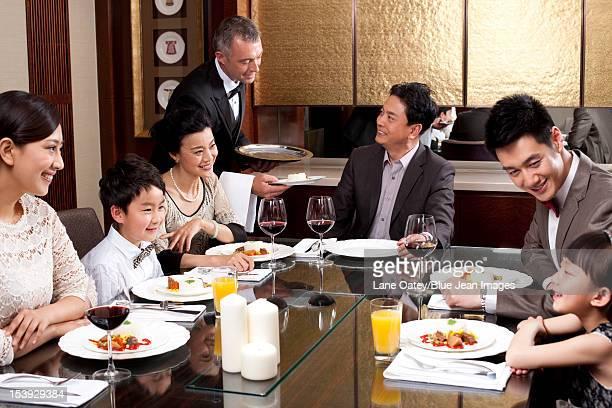 Family having dinner in a luxurious dinning room