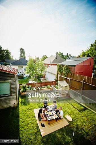 Family having dinner in backyard of home