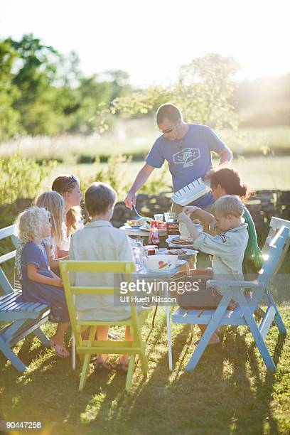 Family having dinner in the garden Sweden.