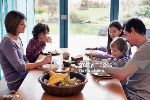 Family having dinner together at table